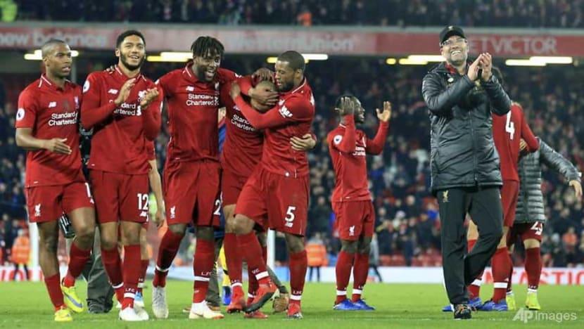 Football: Liverpool's Origi sinks Everton with freak late goal