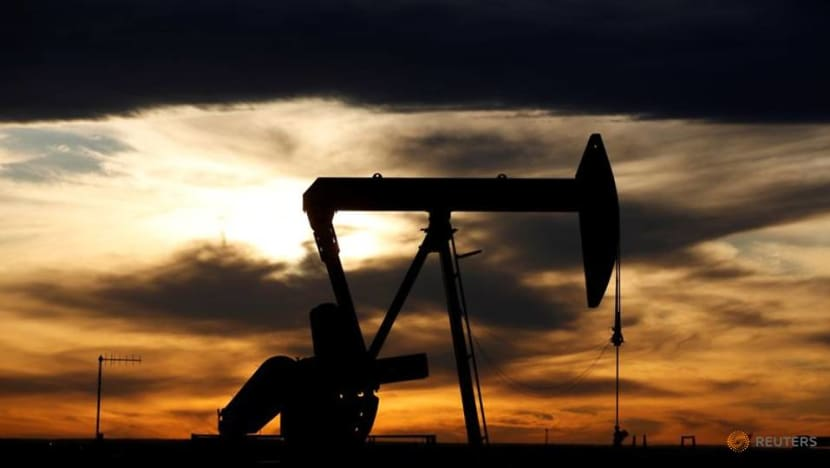 Oil edges lower after jump on US stocks draw