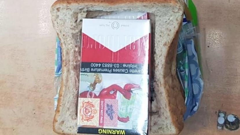 Motorcyclist tries to smuggle cigarettes hidden in loaf of bread into Singapore