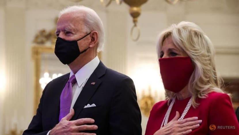 Biden orders masks, quarantine for passengers flying to US in 'wartime' offensive on COVID-19