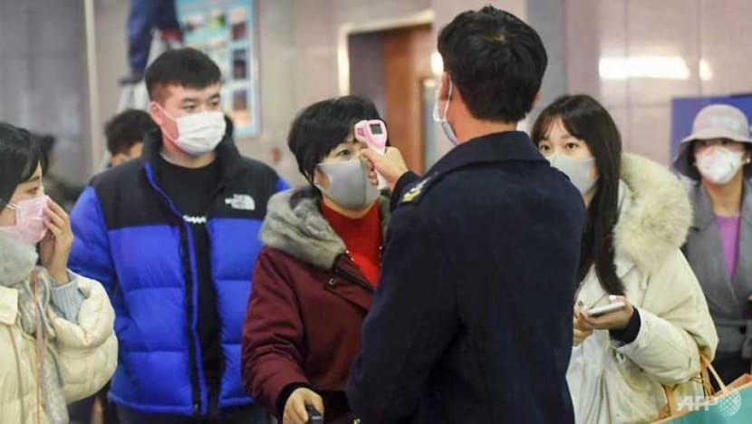 New Chinese city locked down as virus kills abroad