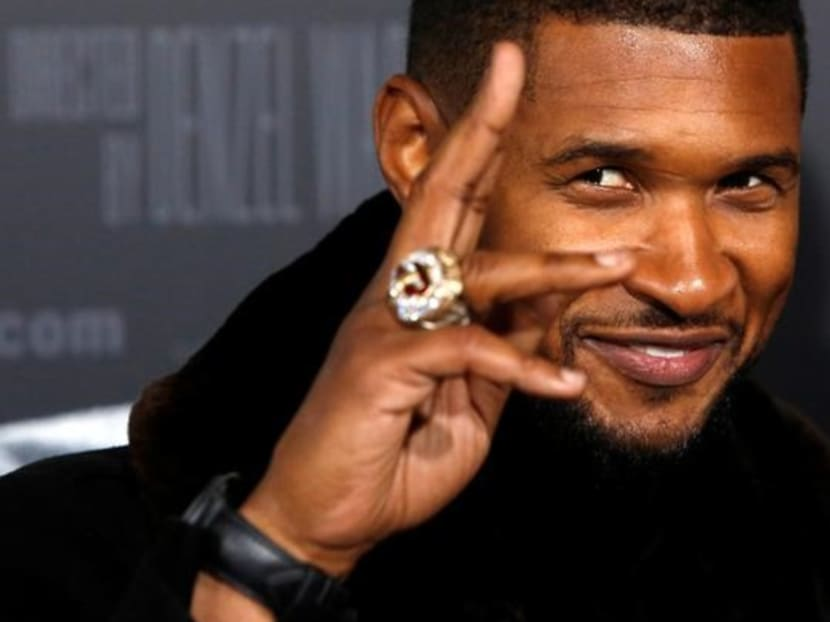 Remember Usher? The 40-year-old singer just got a huge head and neck tattoo