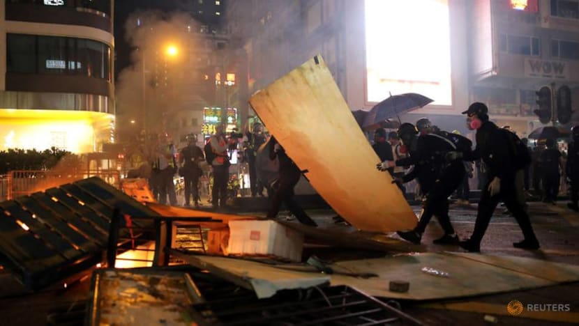 Hong Kong firms, lacking riot insurance, pick up pieces from protest damage