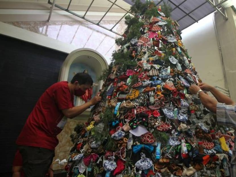 Indonesia church decorates Christmas tree with masks, sanitisers to promote COVID awareness