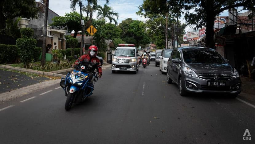In traffic-choked Jakarta, volunteer motorcyclists help ambulances weave through congestion