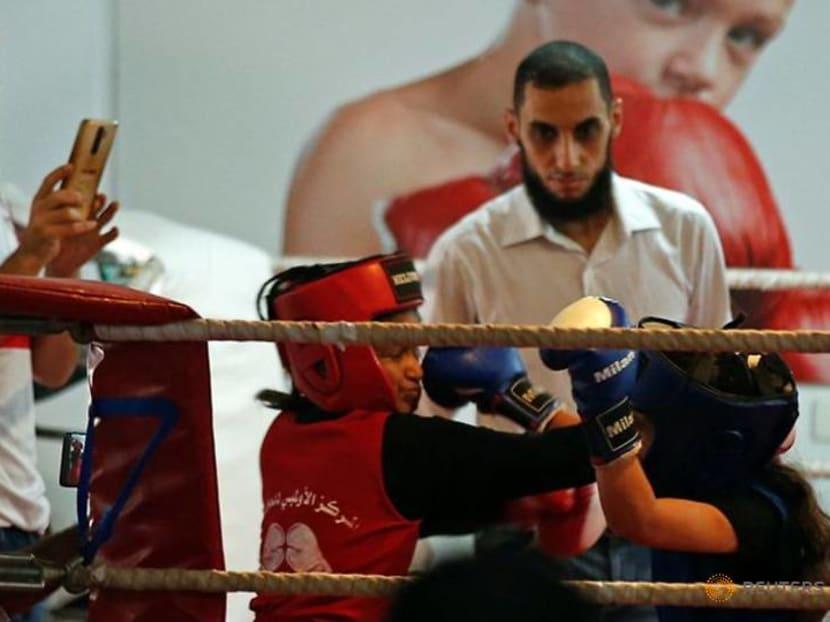 Palestinian girls compete in a rare Gaza boxing contest