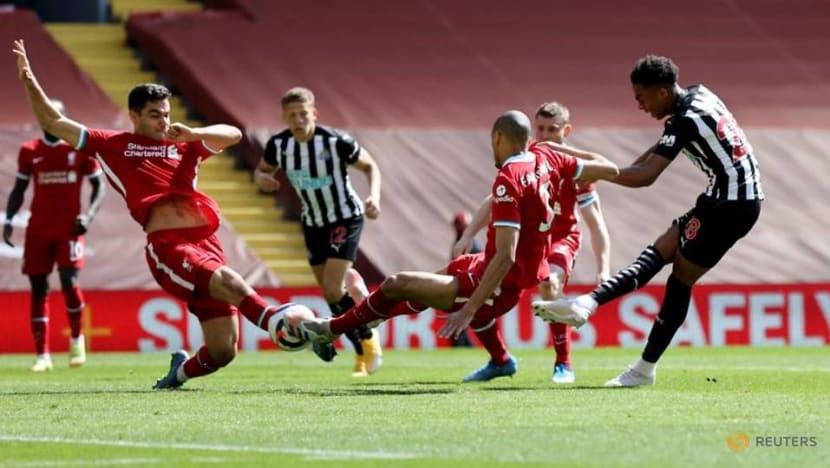 Soccer-Bruce slams handball rules after Newcastle denied at Liverpool