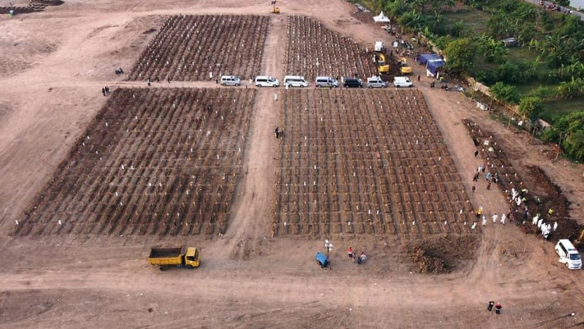 Aerial images of expanding graves capture Indonesia's deadliest days
