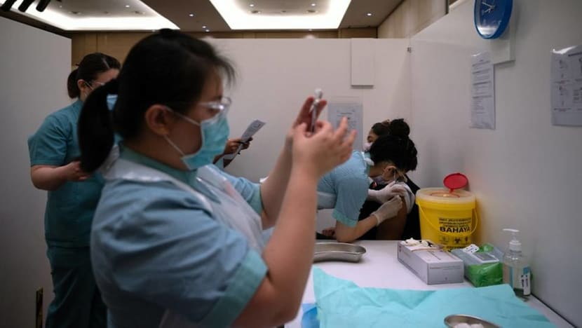 Malaysia's new COVID-19 cases cross 20,000 mark for first time, setting record for 2nd day
