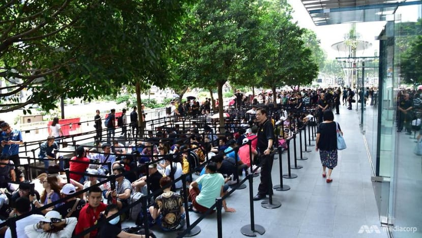 Hundreds queue outside Apple store at Orchard Road a day before launch of new iPhones