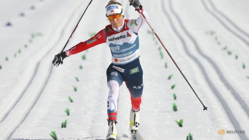 Nordic skiing-Blistering Johaug signs off with 30km gold