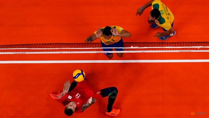 Olympics-Volleyball-Russians stun defending champions Brazil in men's semi-finals