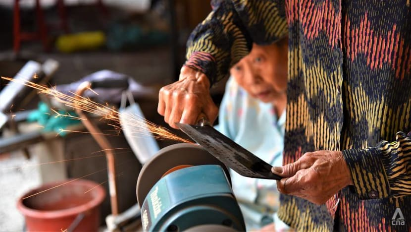 'We do it to keep busy': Elderly sisters continue knife sharpening trade in Kuala Lumpur