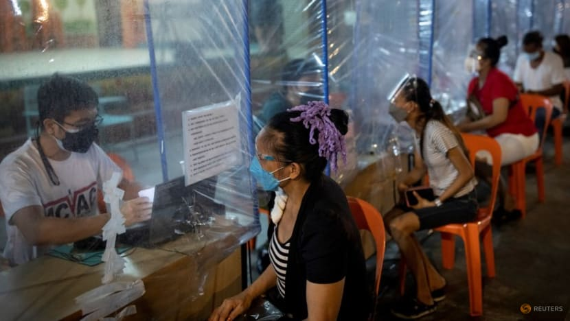 Philippine COVID-19 vaccination centres open 24 hours as Delta variant threat grows