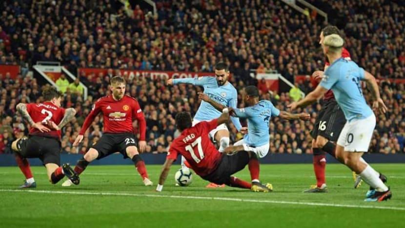 Football: Man City pile on misery for Man Utd to go back top