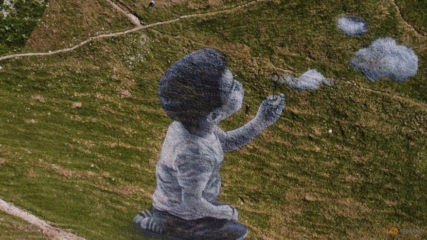 Graffiti artist captures lightness of clouds to lift spirits