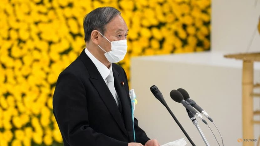 Japan's Suga pledges not to wage war again as ministers visit controversial shrine