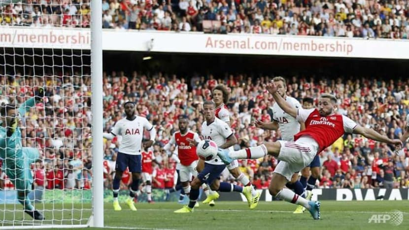 Football: Arsenal fight back to salvage point against Spurs
