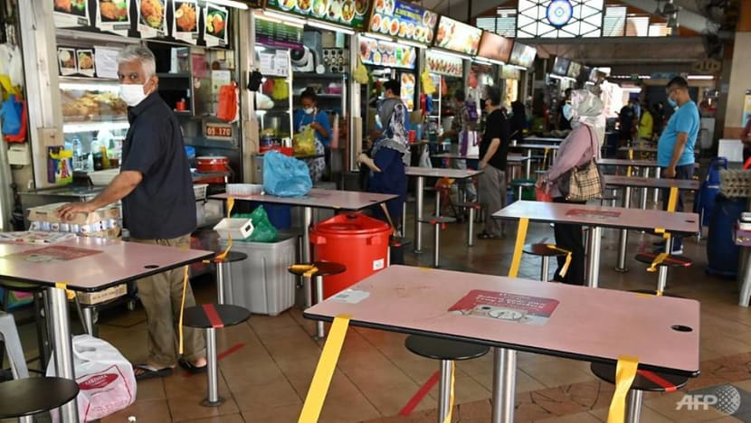 Hawker centres to feature new seating arrangement during Phase 2, hand sanitiser dispensers to be installed: NEA