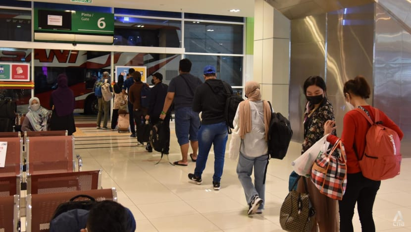 'Even if it's for just one day': Some Malaysians return home to meet family on first day of interstate travel