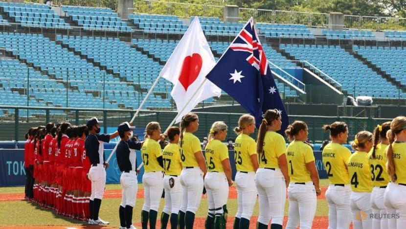 Softball-Relief for Japan, US on wins as action begins at Games