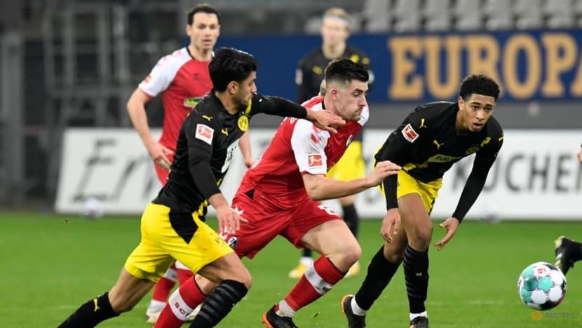 Soccer-Freiburg pull off gritty 2-1 win over Dortmund as Wolfsburg go top