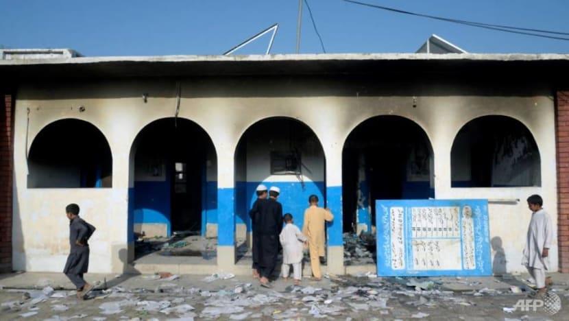 Pakistani vaccine teams confront violence, hysteria in polio battle