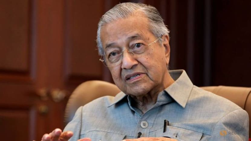 Mahathir says where he sits in parliament is not a cause for dismissal, insists he remains Bersatu chairman