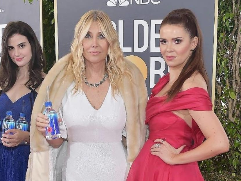 Who's the 'Fiji water girl' who stole the show at the Golden Globes?