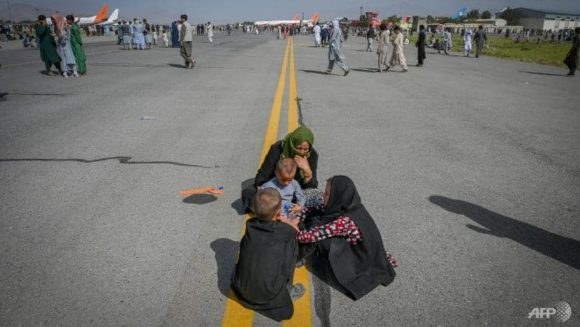 Evacuation flights restart from Kabul after Afghans desperate to flee cleared from airfield