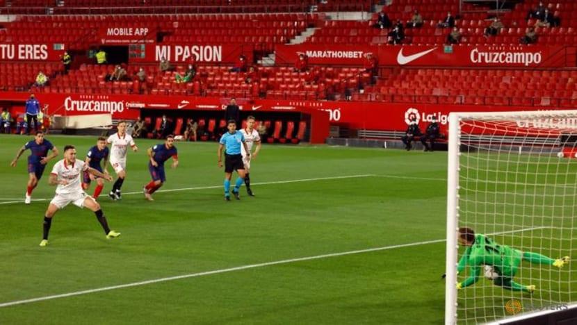 Football: Atletico's title bid falters again with loss at Sevilla