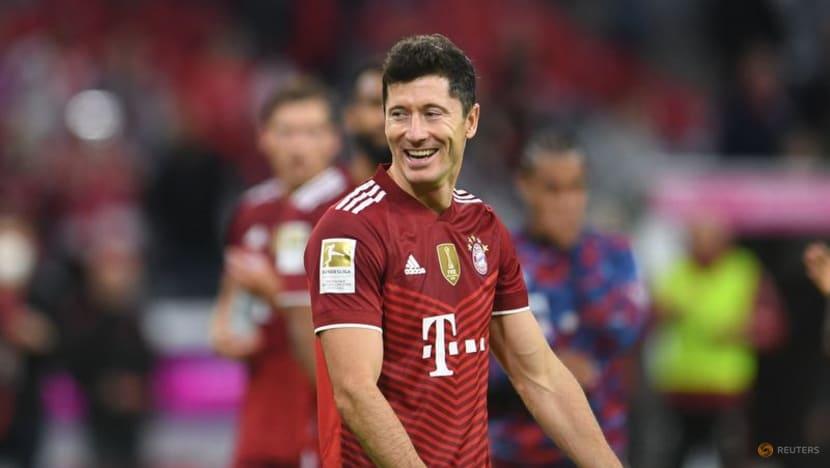 Football:Record-breaking Lewandowski nets hat-trick as Bayern crush Hertha Berlin
