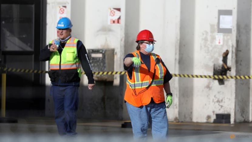 COVID-19 US workplace regulator says vaccinated workers should wear masks
