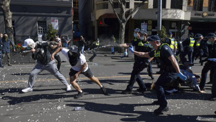 Police arrest hundreds of protesters as Australia reports record COVID-19 cases