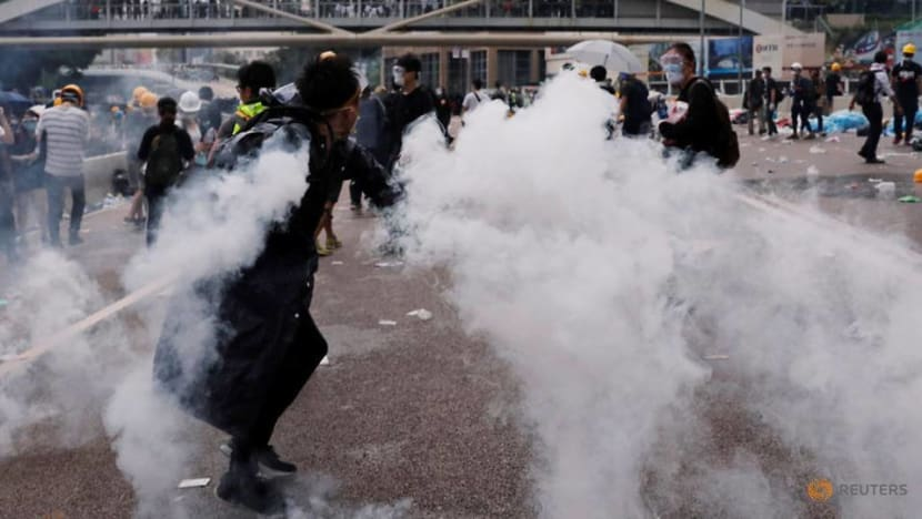 Hong Kong police arrest 11, Beijing voices support for action against 'riots'