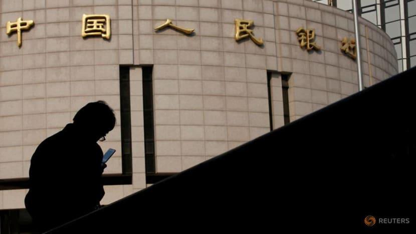 China central bank tries to soothe market nerves after SOE debt shocks
