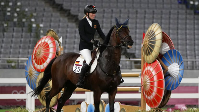 Olympics: Germany's modern pentathlon coach disqualified after punching horse