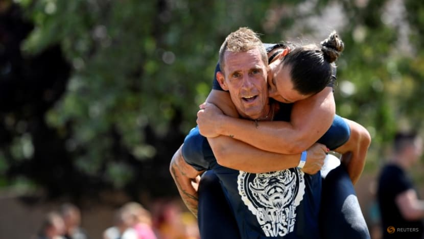 Hungarians grab their partners in nation's wife-carrying contest