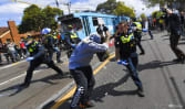 Australian police clash with anti-lockdown protesters as country reports 1,882 new COVID-19 cases